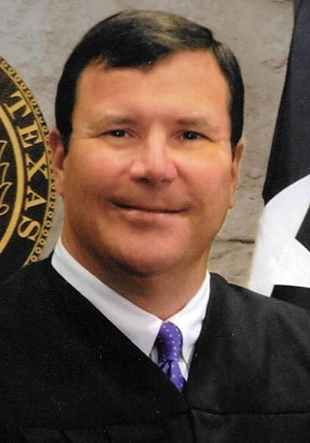 Judge John T. Wooldridge, Mediator & Arbitrator, Houston, Texas.